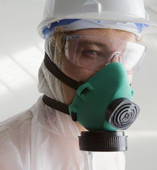 Man wearing protective clothing and gas mask